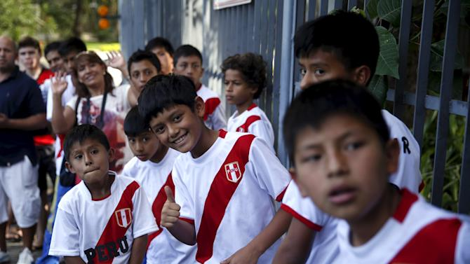 Peruvian soccer fans wait outside Flamengo soccer club, after the presentation of new player Guerrero in Rio de Janeiro