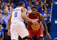 Miami Heat's LeBron James (R) defends as Oklahoma City Thunder's Russell Westbrook drives towards the basket during their game on June 12. James had a team-high 30 points