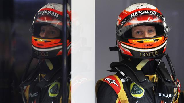 Formula 1 - Grosjean penalised for Ricciardo clash