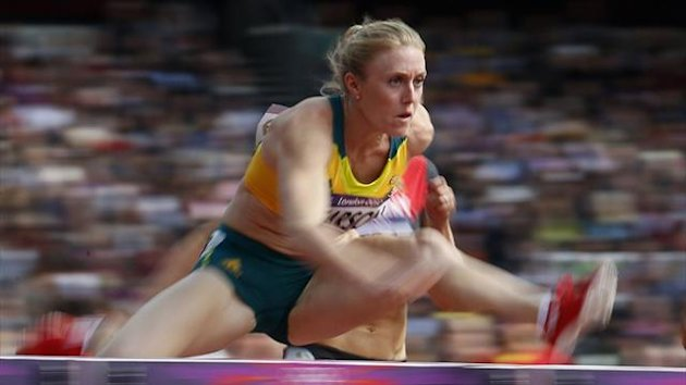 Australia's Sally Pearson competes in her women's 100m hurdles round 1 heat and finishes first during the London 2012 Olympic Games (Reuters)