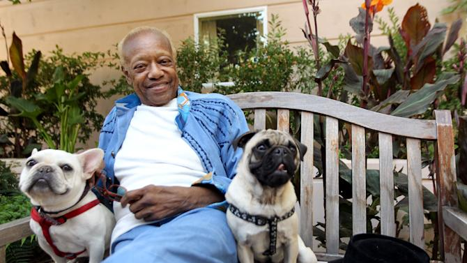 "In this June 22, 2012 photo, musician Bobby Womack sits with his dogs, a French bull dog named Music, left, and a pug named Wo in Los Angeles. With health and drug problems behind him, Womack makes his return with a new album, ""The Bravest Man in the Universe."" (Photo by Matt Sayles/Invision/AP)"
