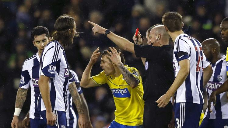 Newcastle United's Debuchy reacts as he is sent off by referee Mason during their English Premier League soccer match against West Bromwich Albion in West Bromwich