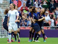 Japan's world champion women footballers celebrate a goal during their 2-1 win over France in the Olympic semi-final. More than 20,000 people have signed an online petition to demand Japan's world champion women footballers be treated equally with their male counterparts when they fly home from the London Olympics