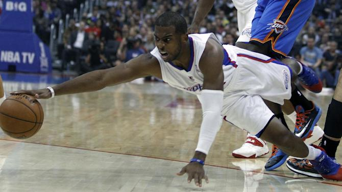 Los Angeles Clippers guard Chris Paul dives to recover the ball against the Oklahoma City Thunder in the first half of their NBA basketball game Wednesday, Nov. 13, 2013, in Los Angeles