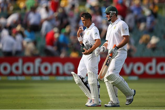 ADELAIDE, AUSTRALIA - NOVEMBER 23:  South African Graeme Smith and team mate Jacques Rudolph walk off the field at the conclusion of play during day two of the Second Test match between Australia and