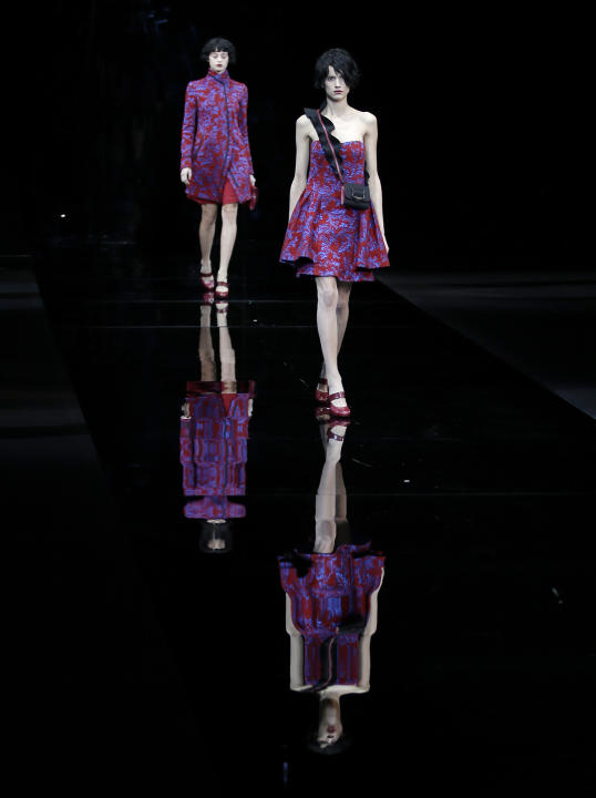 Models wear creations for Emporio Armani women's Fall-Winter 2015-2016 collection, part of Milan Fashion Week, unveiled in Milan, Italy, Friday, Feb. 27, 2015. (AP Photo/Antonio Calanni)