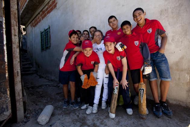 Caacupe cricket team players pose for a picture at the Villa 21-24 slum in Buenos Aires, Argentina, Saturday, March 22, 2014. The International Cricket Council has recognized the team, formed from the
