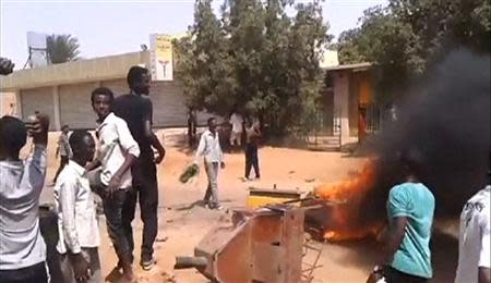 Demonstrators gather at Kalakla Market during a protest against a cut in fuel subsidies in south Khartoum in this still image taken from video September 25, 2013. REUTERS/Kidintakar Radio Station/Storyful/via Reuters TV