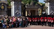 Guardsmen march past onlookers into Buckingham Palace during the Changing of the Guard in London in July 23, 2012. The decision to publish photos of Prince William's wife Catherine topless has incensed the royal family, whose lawyers have obtained a civil injunction and sought criminal charges in Paris in a bid to curb their spreading.