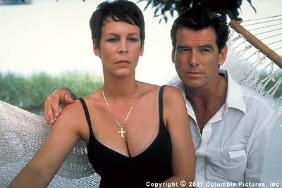 Charming but ruthless British spy Osnard ( Pierce Brosnan ) attempts to seduce Louisa Pendel ( Jamie Lee Curtis ), the wife of the Cockney ex-con turned tailor he is hoping to recruit, in the Columbia Pictures spy thriller, The Tailor of Panama