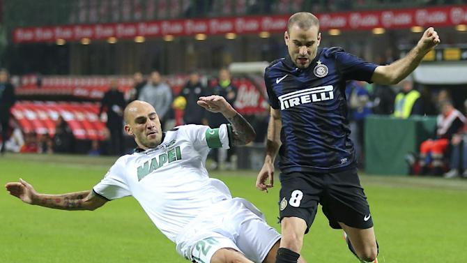 Inter Milan forward Rodrigo Palacio, right, of Argentina, is tackled by Sassuolo defender Paolo Cannavaro during the Serie A soccer match between Inter Milan and Sassuolo at the San Siro stadium in Milan, Italy, Sunday, Feb. 9, 2014