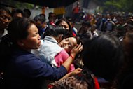 Daughter of Nepalese mountaineer Ang Kaji Sherpa, killed in an avalanche on Mount Everest, cries during the funeral ceremony in Katmandu, Nepal, Monday, April 21, 2014. Buddhist monks cremated the remains of Sherpa guides who were buried in the deadliest avalanche ever recorded on Mount Everest, a disaster that has prompted calls for a climbing boycott by Nepal's ethnic Sherpa community. The avalanche killed at least 13 Sherpas. Three other Sherpas remain missing. (AP Photo/Niranjan Shrestha)