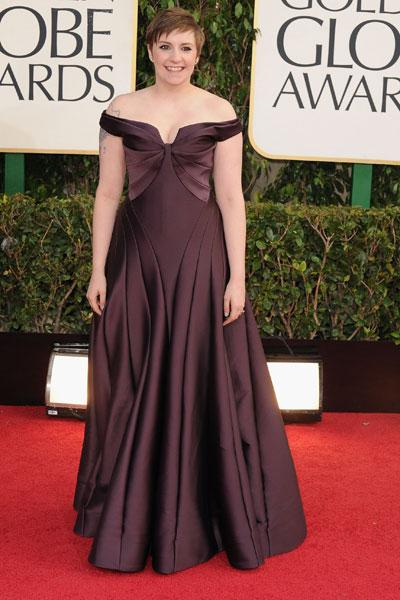 Lena Dunham: It's a miracle! 'Girls' star Lena Dunham is wearing a full-on gown! The plum-coloured frock is super flattering on the writer/director/actor and works well with her cute pixie cut. (Photo