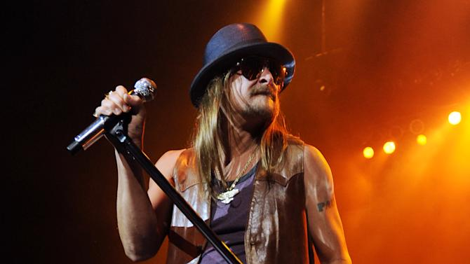 "FILE - This Dec. 30, 2012 file photo shows Kid Rock performing at the Seminole Hard Rock Hotel & Casinos' Hard Rock Live! in Hollywood, Fla. It's a crowded tour market and everyone is competing for your entertainment dollar. Kid Rock recently called high ticket prices for the Timberlake-Hova Legends of the Summer Tour ""garbage"" and is countering with $20 tickets for his own Best Night Ever Tour.  (Photo by Jeff Daly/Invision/AP, file)"