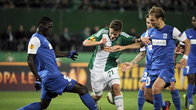Rapid's Louis Schaub, center, Genk's Serigne Mbodji, left, and Julien Gorius challenge for the ball during their Europa League  group G soccer match between SK Rapid Vienna and KRC Genk, in  Vienna, Austria, Thursday, Nov. 7, 2013
