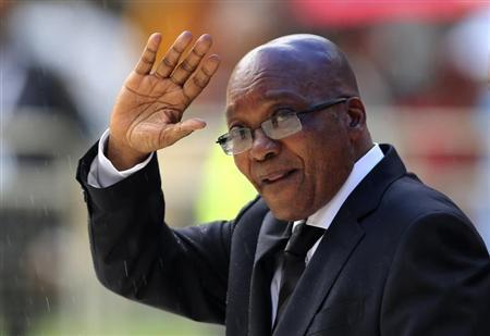 South African President Zuma waves at national memorial service for Mandela in Johannesburg