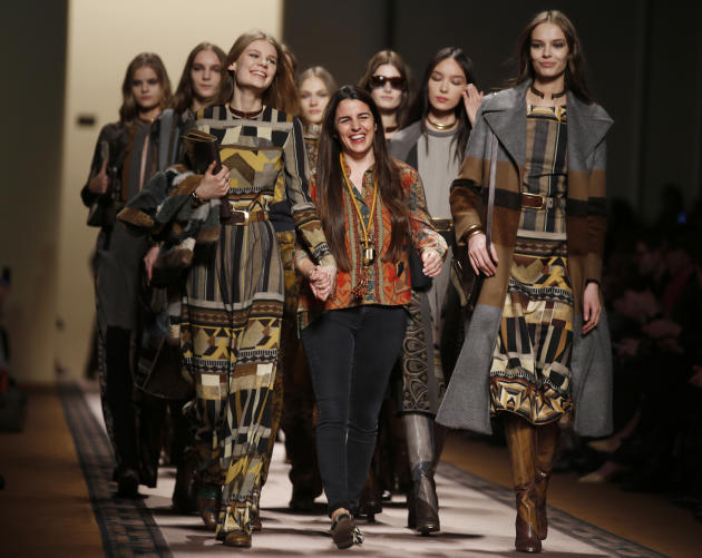 Italian fashion designer Veronica Etro, center, acknowledges the applause at the end of her Etro women's Fall-Winter 2015-16 show, part of Milan Fashion Week, unveiled in Milan, Italy, Friday, Feb