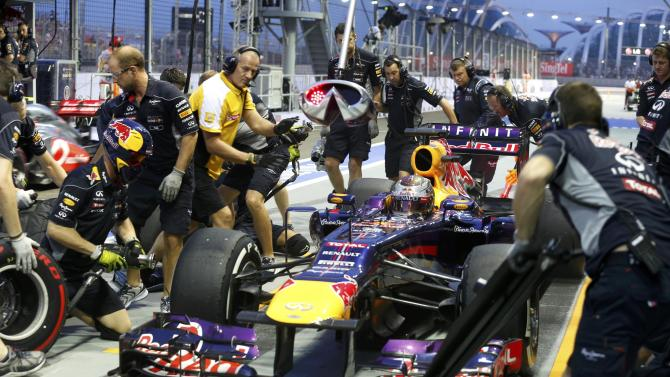 Red Bull Formula One driver Vettel makes a pit stop during the third practice session of the Singapore F1 Grand Prix in Singapore