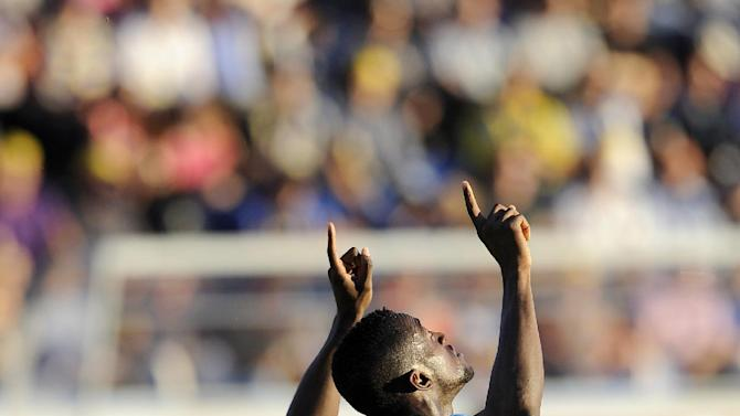 FC Porto's Jackson Martinez celebrates after scoring the opening goal against Arouca during their Portuguese League soccer match at the Municipal Stadium, in Arouca, Portugal, Sunday Oct. 6, 2013