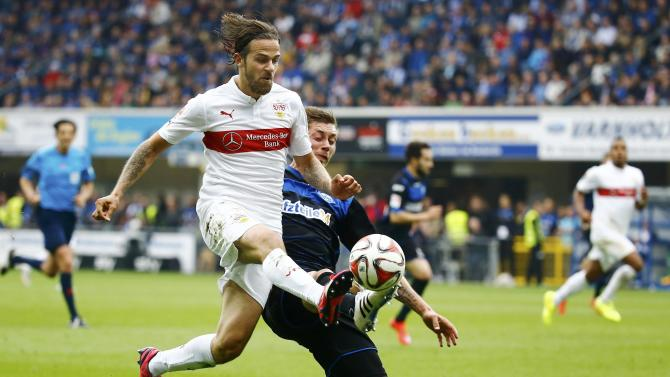 VFB Stuttgart's Harnik fights for the ball with SC Paderborn's Strohdiek during their German Bundesliga match in Paderborn