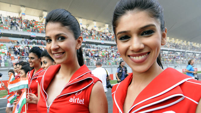 Grand Prix grid girls stand on the track during the drivers' parade in the Formula One Indian Grand Prix at the Buddh International circuit in Greater Noida, southeastern outskirts of New Delhi on October 30, 2011.  AFP PHOTO / TOSHIFUMI KITAMURA (Photo credit should read TOSHIFUMI KITAMURA/AFP/Getty Images)