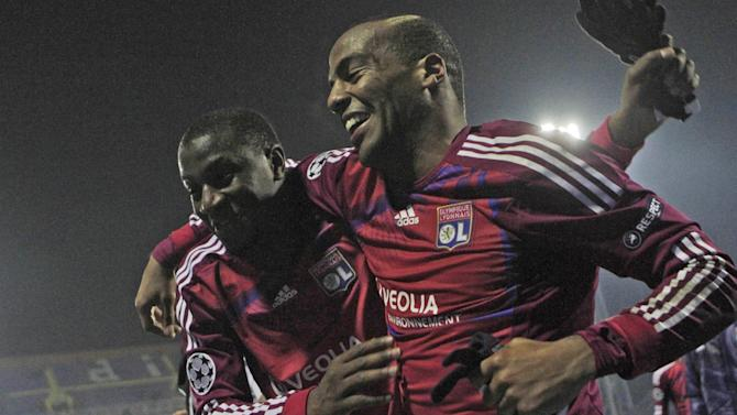 Lyon's Jimmy Briand, right and Mouhamadou Dabo celebrate victory in the Champions League group D soccer match between Dinamo Zagreb and Lyon, in Zagreb, Croatia, Wednesday, Dec. 7, 2011. (AP Photo/Darko Bandic)