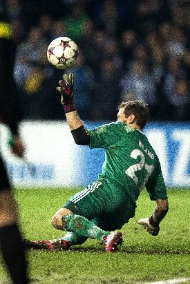 FC Copenhagen's goalkeeper Johan Wiland saves a penalty from Real Madrid's Christiano Ronaldo, during the Champions League, Group B, soccer match between FC Copenhagen and Real Madrid, at Parken in Copenhagen, Denmark, Tuesday Dec. 10, 2013