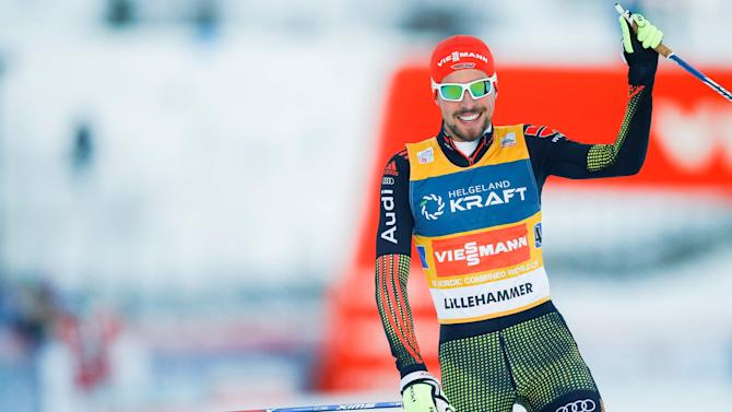 Johannes Rydzek celebrates after winning the mens Nordic Combined team 4x5km race at the FIS World Cup in Lillehammer