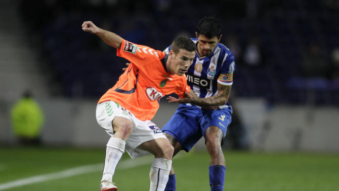 Porto's Lucho battles for the ball with Vitoria Setubal's Tiba during their Portuguese Premier League soccer match at Dragao stadium in Porto