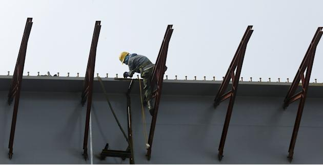 A man works at a construction site in Hanoi
