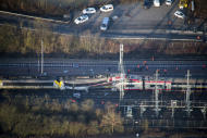 In this image provided by the Luxembourg Police Grand Ducale, an aerial view of the wreckage of a passenger train and a freight train after they collided in Bettemberg, Luxembourg on Tuesday, Feb. 14, 2017. The collision left one person dead and at least four injured. (Luxembourg Police Grand Ducale via AP)