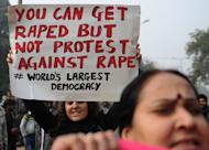 Demonstrators shout slogans and wave placards as they move towards India Gate in New Delhi, on December 27, 2012, during a protest calling for better safety for women, following the rape of a student in the Indian capital