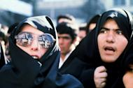"""Iranian women demonstrate outside the US Embassy on November 29, 1979. The film """"Argo"""" openly takes liberties with the facts about the 1979 hostage crisis. In a white-knuckle climax, for example, Iranian guards speed along a runway next to a plane carrying the escaping diplomats, threatening to stop it from taking off. That didn't happen"""