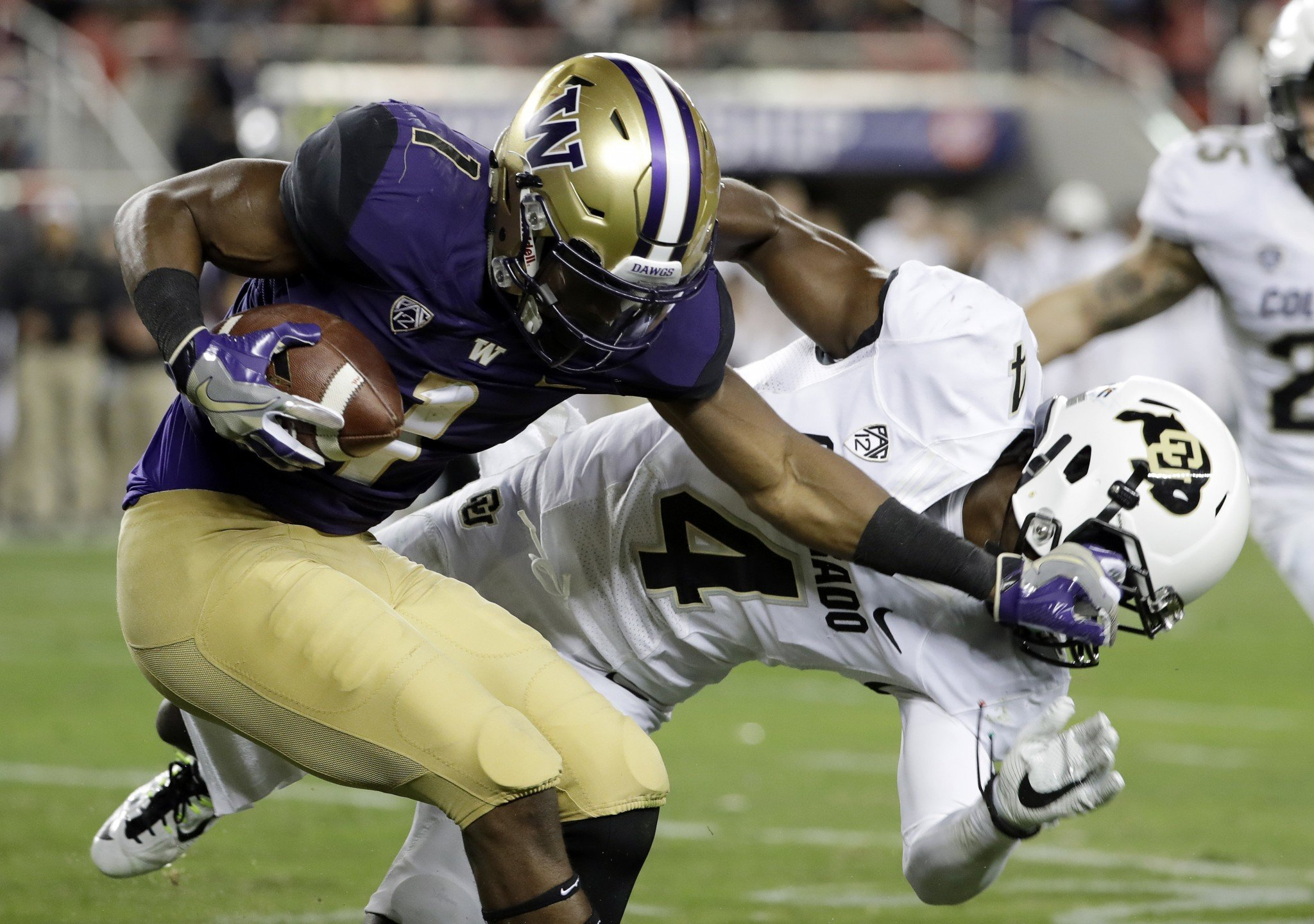 Washington receiver John Ross had a highlight reel touchdown catch in the second half of the Pac-12 title game. (AP Photo/Marcio Jose Sanchez)