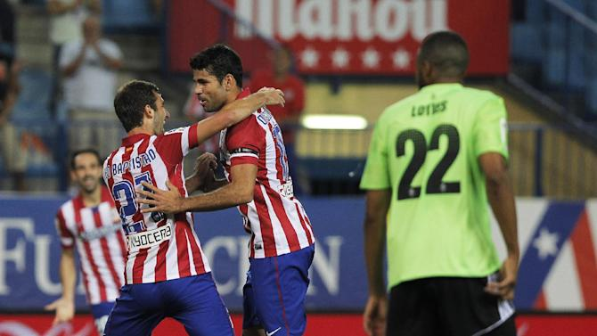 Atletico de Madrid's Diego Costa from Brazil, second left, celebrates his goal with Leo Baptistao, left, during a Spanish La Liga soccer match against Osasuna at the Vicente Calderon stadium in Madrid, Spain, Tuesday, Sept. 24, 2013