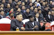 "Kim Jong-Un (front left) and Dennis Rodman at a basketball game in Pyongyang on February 28, 2013. Flamboyant former NBA star Rodman has lauded North Korea's new leader as an ""awesome kid"" following an unprecedented meeting with Kim Jong-Un at a basketball game in Pyongyang"