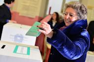Elsa, wife of Italy's outgoing Prime Minister Mario Monti, casts her ballot in a polling station on February 24, 2013 in Milan. Polls reopened in Italy on Monday for a second and final day of voting in a critical election for the future of the eurozone in which the centre-left Democratic Party is expected to win but fall short of a governing majority