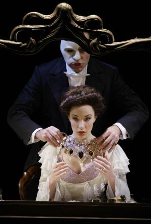 """FILE - In this March 3, 2010 file photo, The Phantom, played by Ramin Karimloo, right, performs a scene with Christine, played by Sierra Boggess, from the sequel to The Phantom of the Opera, """"Love Never Dies"""" at the Adelphi Theatre in central London. Producers said Thursday, Oct. 18, 2012, that the actress will reprise the role of leading lady Christine Daae in """"The Phantom of the Opera,"""" to help celebrate the show's 25th anniversary on Broadway. She starts the week of Jan. 21, 2013. (AP Photo/Joel Ryan, File)"""