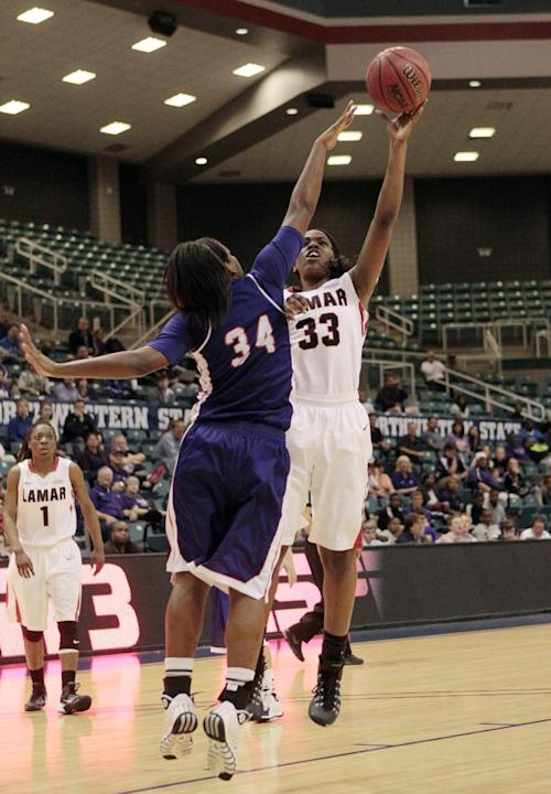 Lamar's Kiandra Bowers (33) shoots over Northwestern State's Kourtney Pennywell (34) during the second half of an NCAA college basketball game in the semifinal round of the Southland Conferenc