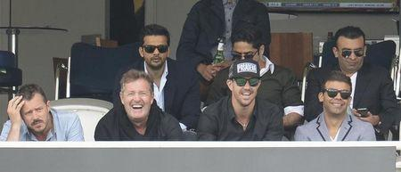 Former England player Pietersen watches from sponsors box with Piers Morgan during first cricket test match between England and Sri Lanka at Lord's cricket ground in London