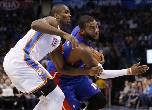 Detroit Pistons forward Greg Monroe drives around Oklahoma City Thunder forward Serge Ibaka during the first quarter of an NBA basketball game in Oklahoma City, Wednesday, April 16, 2014. (AP Photo/Su
