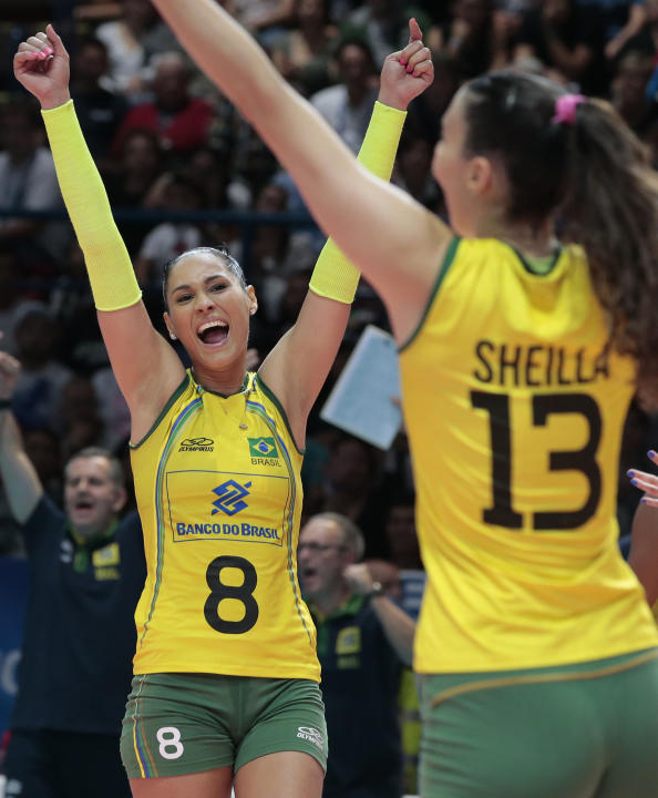 Brazil's Jaqueline Pereira De Carvalho Endres, left, and teammate Sheilla Castro De Paula Blassioli celebrate after winning the women's Volleyball World Championships third place final match a