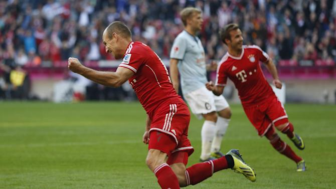 Bayern's Arjen Robben of the Netherlands celebrates after scoring his side's first goal during the German first division Bundesliga soccer match between FC Bayern Munich and FSV Mainz 05, in Munich, southern Germany, Saturday, Oct. 19, 2013