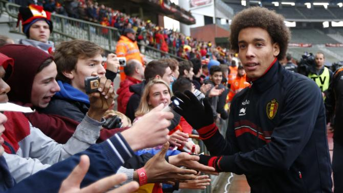 Belgium's soccer team player Witsel greets supporters during a training session in Brussels