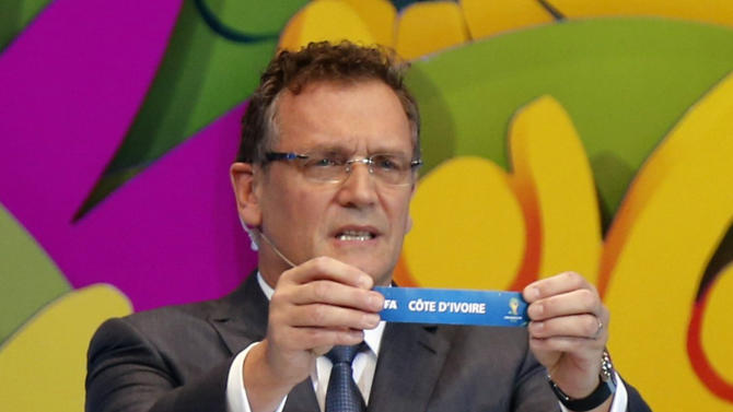"""FIFA Secretary General Jerome Valcke holds the slip showing """"Ivory Coast"""" during the draw for the 2014 World Cup at the Costa do Sauipe resort in Sao Joao da Mata"""