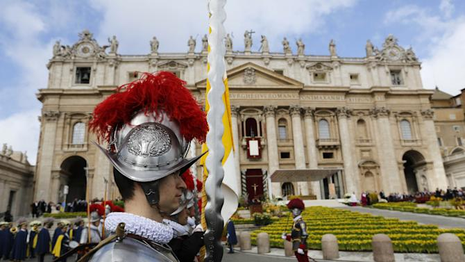 "Swiss guards stand in St. Peter's square at the Vatican on the occasion of the celebration of the Easter mass Sunday, March 31, 2013. ""Our daily problems and worries can wrap us up in ourselves, in sadness and bitterness, and that is where death is,"" he said. ""Let the risen Jesus enter your life, welcome him as a friend, with trust: he is life!"" said Pope Francis during the Easter vigil. (AP Photo/Andrew Medichini)"