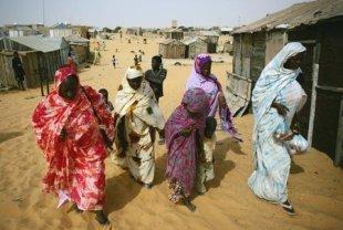 Mauritanians ex-slaves walk in a suburb outside Mauritania's capital Nouakchott in a file photo. REUTERS/Rafael Marchante