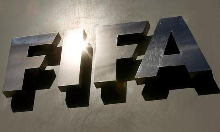 The sun is reflected in FIFA's logo in front of its headquarters in Zurich