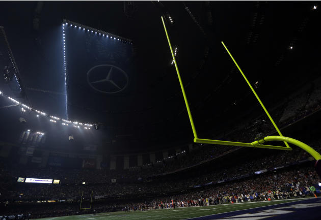 Half the lights are out in the Superdome during a power outage in the second half of the NFL Super Bowl XLVII football game between the San Francisco 49ers and Baltimore Ravens on Sunday, Feb. 3, 2013