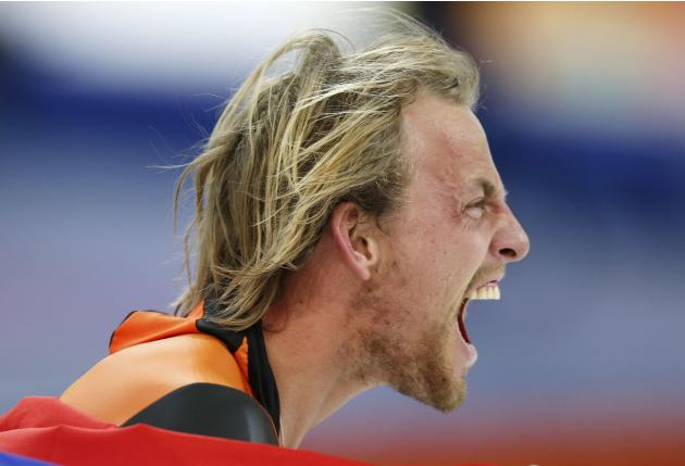 Winner Michel Mulder of the Netherlands celebrates during the men's 500 metres speed skating race at the Adler Arena during the 2014 Sochi Winter Olympics